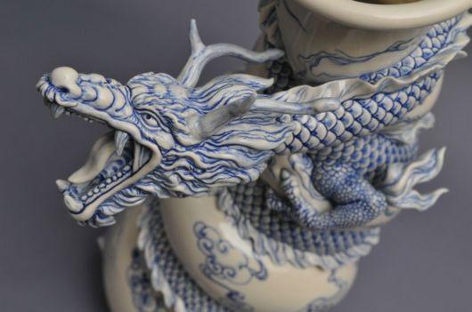 Tsang Sculpts a Dragon Strangling A Porcelain Vase
