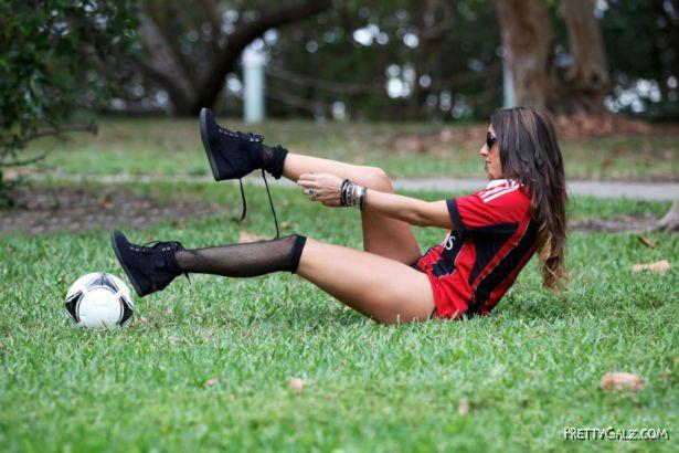 Claudia Romani Playing Football On The Miami Beach