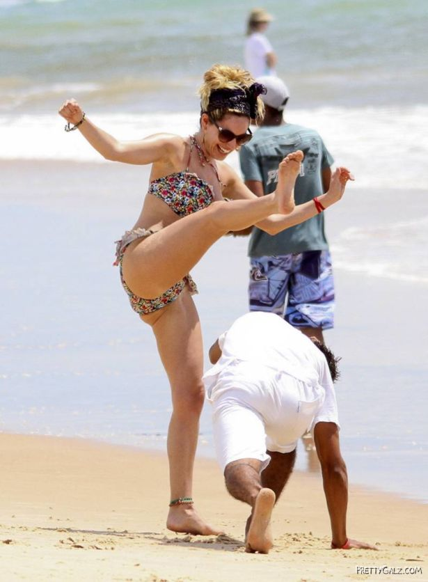 Kelly Brook Having Fun At Beach